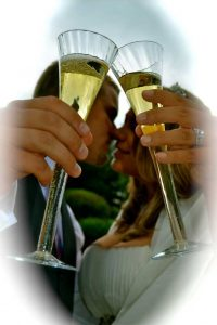 Bride and Groom toasting and kissing