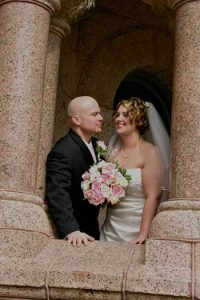 Happy wedding couple at historic Wise County Texas Courthouse