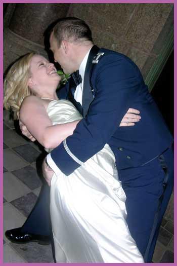 Groom dipping his bride