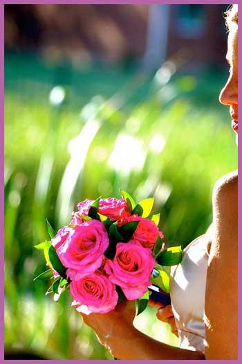 Bride holding pink bridal bouquet