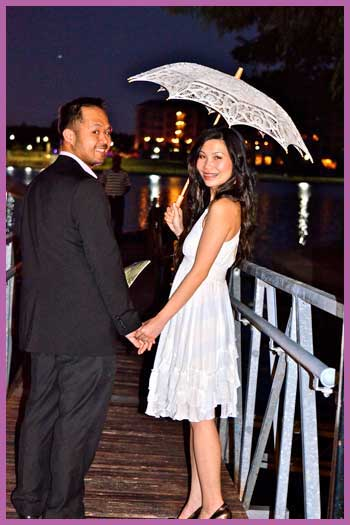 Wedding couple standing on pier